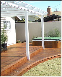 wood patio, pergola, hot tub
